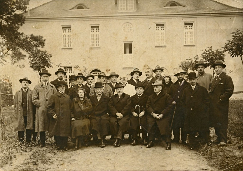 Shimone is second from the left, standing.
